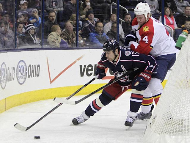 Florida Panthers' Dylan Olsen, right, chases Columbus Blue Jackets' Brandon Dubinsky behind the net during the second period of an NHL hockey game Saturday, March 1, 2014, in Columbus, Ohio. (AP Photo/Jay LaPrete)