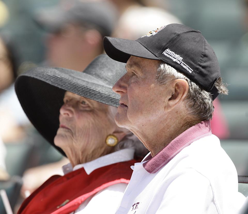George H.W. and Barbara Bush attend a baseball game between the Pittsburgh Pirates and the Houston Astros at Minute Maid Park on April 25, 2010, in Houston.