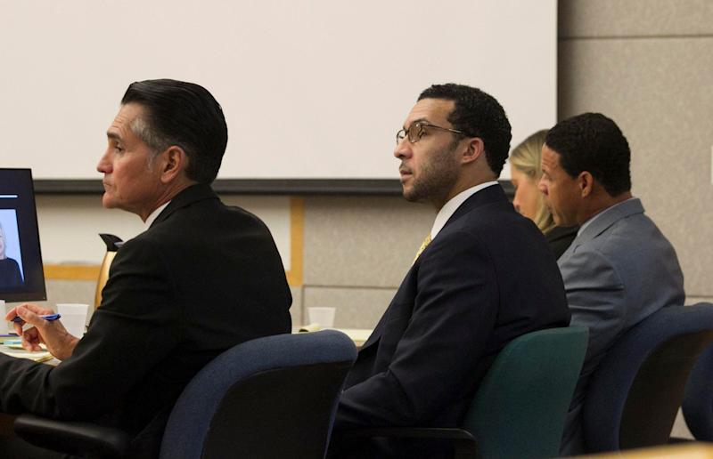 Former NFL football player Kellen Winslow Jr., center, sits with his attorneys Marc Carlo, left, and Brian Watkins, third from left, during his rape trial, Monday, May 20, 2019, in Vista, Calif. (John Gibbins/The San Diego Union-Tribune via AP, Pool)