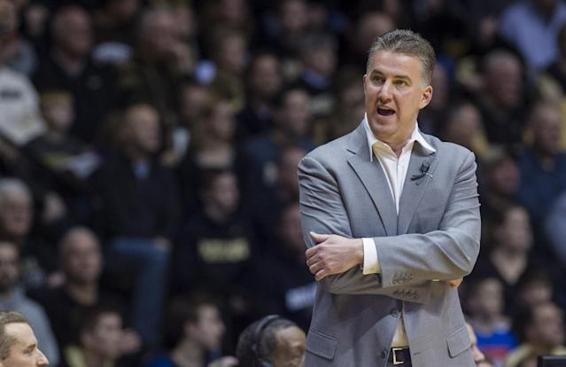 Purdue head coach Matt Painter reacts toward an official after a foul call early in the first half of an NCAA college basketball game, Saturday, Jan. 25, 2014, in West Lafayette, Ind. (AP Photo/Doug McSchooler)