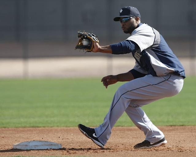 Seattle Mariners second baseman Robinson Cano (22) covers second base during spring training baseball practice, Tuesday, Feb. 18, 2014, in Peoria, Ariz. (AP Photo/Rick Scuteri)