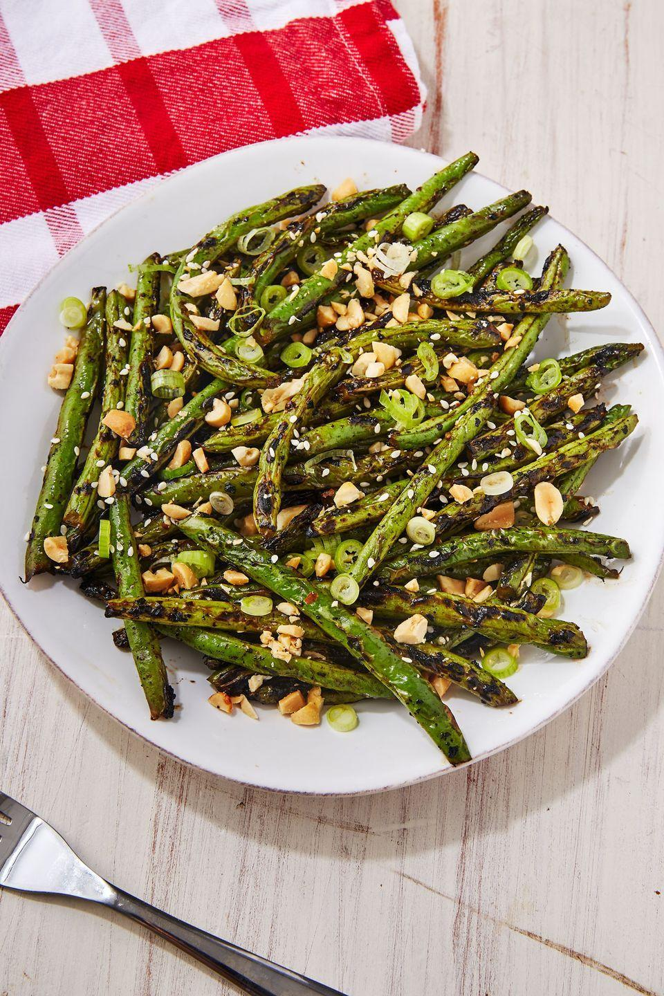 """<p>Very underrated. </p><p>Get the recipe from <a href=""""https://www.delish.com/cooking/recipe-ideas/a22243865/grilled-green-beans-recipe/"""" rel=""""nofollow noopener"""" target=""""_blank"""" data-ylk=""""slk:Delish"""" class=""""link rapid-noclick-resp"""">Delish</a>. </p>"""