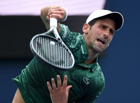 FILE PHOTO: Aug 7, 2018; Toronto, Ontario, Canada; Novak Djokovic of Serbia serves against Mirza Basic of Bosnia and Herzegovina (not shown) in the Rogers Cup tennis tournament at Aviva Centre. Mandatory Credit: Dan Hamilton-USA TODAY Sports