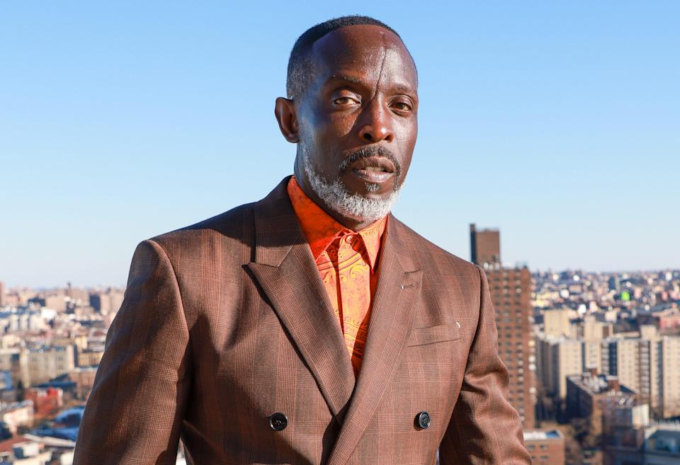 Michael K. Williams dressed in a brown suit