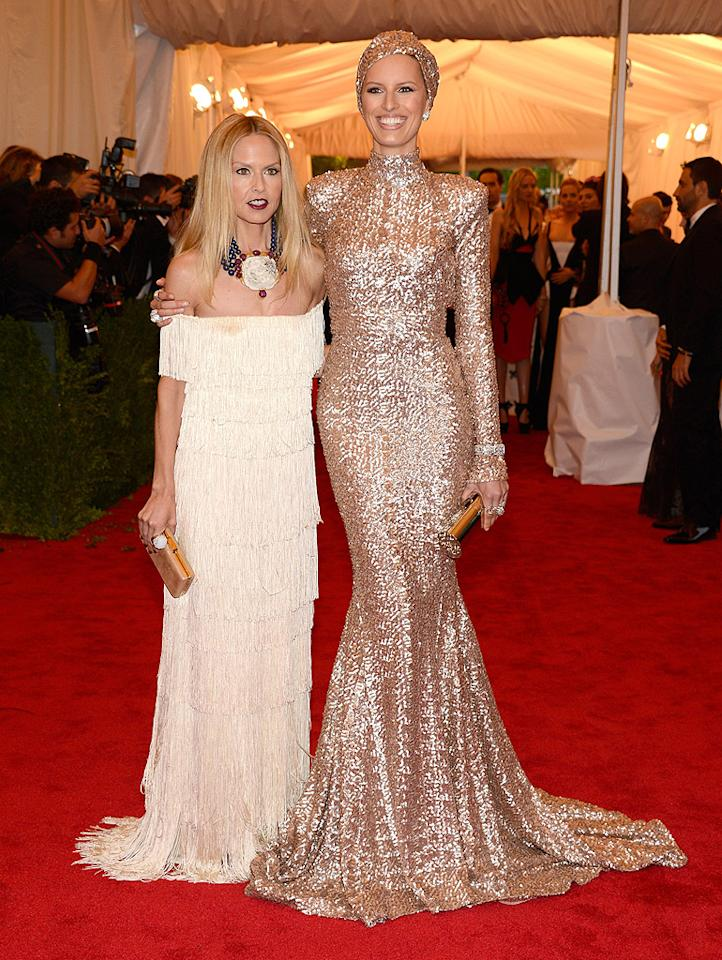 "<p class=""MsoNormal"">Rachel Zoe (left) showed off her handiwork on model Karolina Kurkova, who donned one of Rachel's pieces – a long-sleeve gold sequin gown with a train and matching turban – from the Rachel Zoe Collection. The celebrity stylist wore one of her own creations too … but didn't look quite as dramatic as Karolina!</p>"