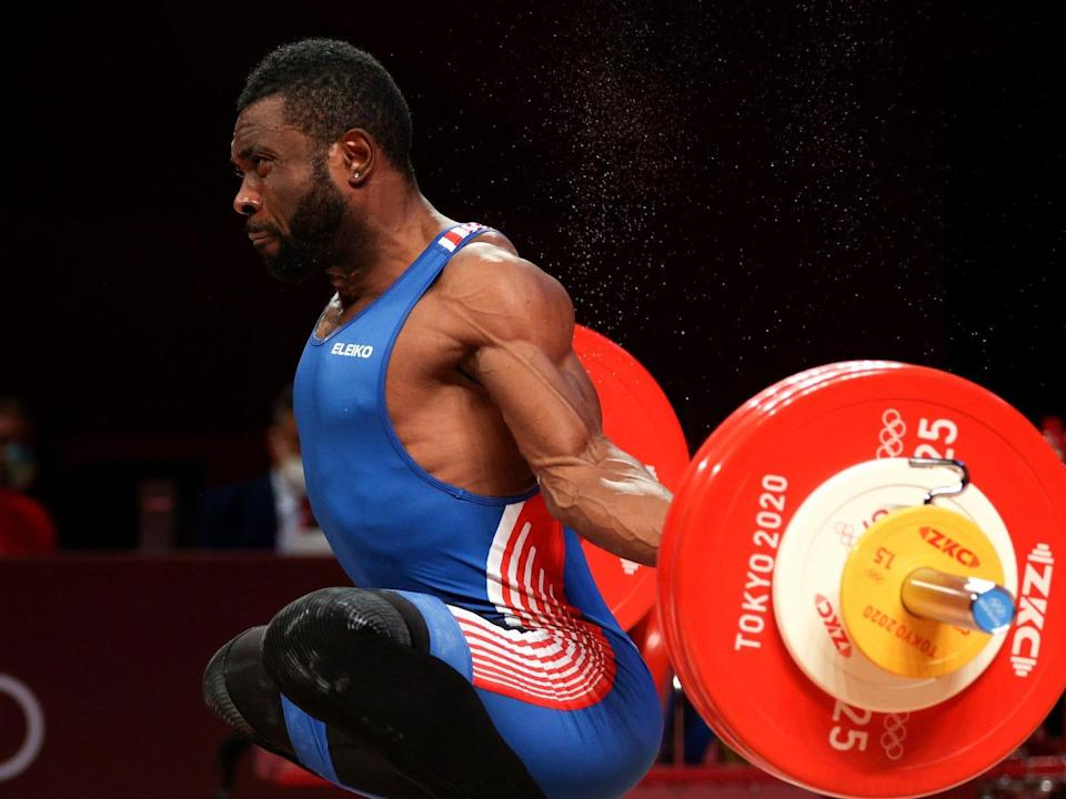 French weightlifter competes during the Tokyo Olympics.
