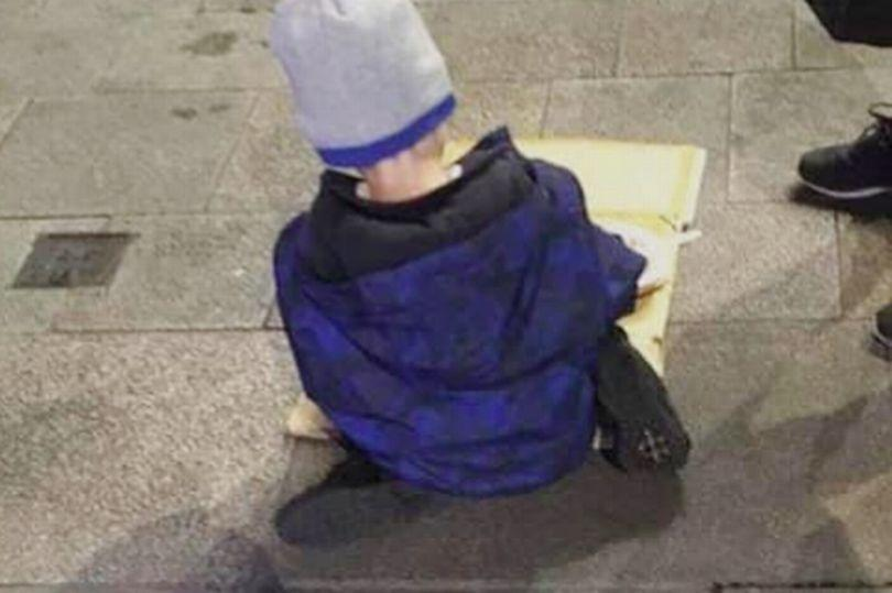 A heart-breaking image of a young homeless boy eating his dinner out of a cardboard box on the pavement of a city street in Ireland has caused widespread outcry on social media. (Facebook)