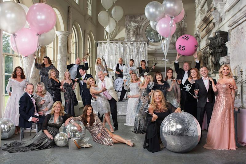 Winners from each year of the lottery's existence posing for a Vanity Fair-style photo shoot to mark The National Lottery's 25th anniversary (PA)