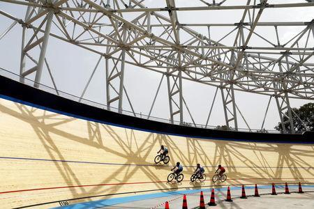 FILE PHOTO: Professional cyclists ride around the track during the unveiling of Israel's first Velodrome in Tel Aviv, Israel May 1, 2018. REUTERS/Nir Elias
