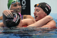 Gold medalist Lydia Jacoby, left, of the United States, is embraced by bronze medalist and compatriot Lilly King after winning the final of the women's 100-meter breaststroke at the 2020 Summer Olympics, Tuesday, July 27, 2021, in Tokyo, Japan. (AP Photo/Matthias Schrader)