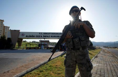 A Turkish soldier stands guard in front of the Aliaga Prison and Courthouse complex in Izmir, Turkey July 18, 2018. REUTERS/Kemal Aslan