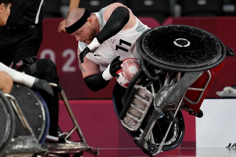 Mark Ingemann Peters of Denmark falls during a pool phase group match of wheelchair rugby.