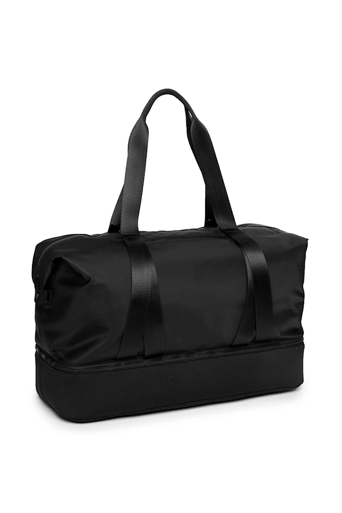"""<h2>Alo City Zen Duffle</h2><br>This sleek duffle is made for athletes on the go. It features stretchy outer straps to hold a yoga mat, a bottom zip compartment for shoes or dirty laundry, and several inside and outside pockets. <br><br><em>Shop <strong><a href=""""https://www.aloyoga.com/"""" rel=""""nofollow noopener"""" target=""""_blank"""" data-ylk=""""slk:Alo"""" class=""""link rapid-noclick-resp"""">Alo</a></strong></em><br><br><strong>Alo Yoga</strong> City Zen Duffle, $, available at <a href=""""https://go.skimresources.com/?id=30283X879131&url=https%3A%2F%2Fwww.aloyoga.com%2Fproducts%2Fw7122r-city-zen-duffle-black"""" rel=""""nofollow noopener"""" target=""""_blank"""" data-ylk=""""slk:Alo Yoga"""" class=""""link rapid-noclick-resp"""">Alo Yoga</a>"""