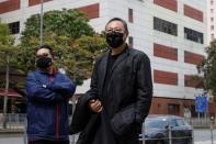 Pro-democracy activist Benny Tai reports to the police station over the national security law charges, in Hong Kong