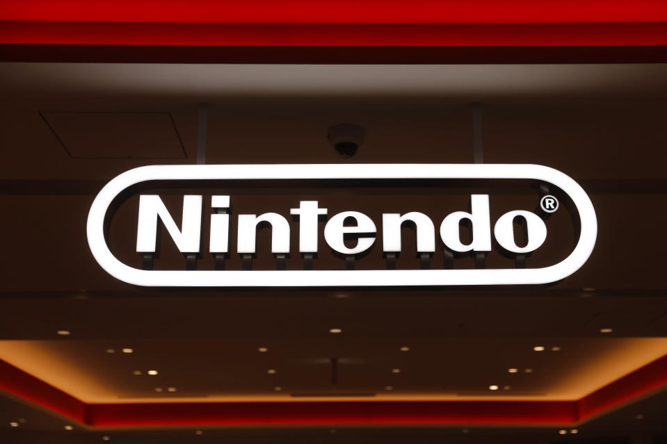 FILE - In this Jan. 23, 2020, file photo, a Nintendo sign is seen at the company's official store in the Shibuya district of Tokyo. Nintendo Co.'s profit for the fiscal year ended in March jumped 86% on healthy sales of the Switch handheld machine as people staying at home over the pandemic turned to video games. (AP Photo/Jae C. Hong, File)