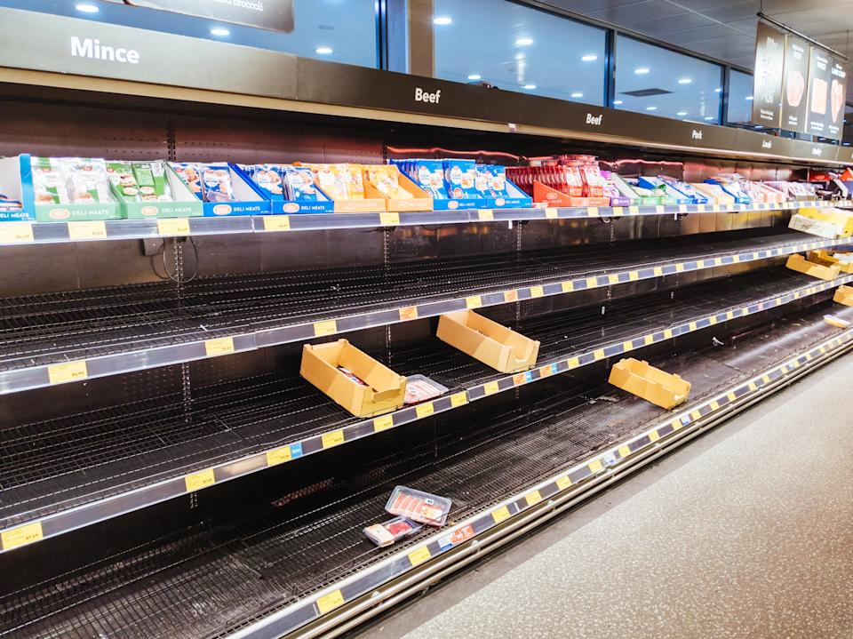 Empty supermarket shelves were a common sight just weeks before the UK lockdown in March. Credit: Getty.