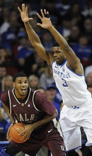 Arkansas-Little Rock's Courtney Jackson, left, looks for help from the defense of Kentucky's Terrence Jones during the second half of their NCAA college basketball game, Tuesday, Jan. 3, 2012, at Freedom Hall in Louisville, Ky. Kentucky defeated UALR 73-51. (AP Photo/Timothy D. Easley)