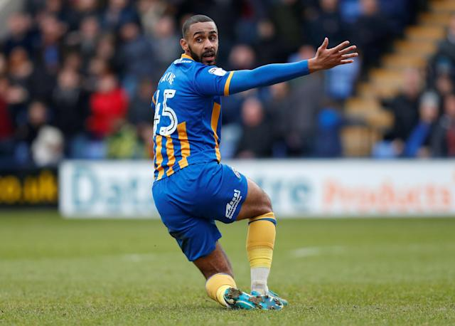 """Soccer Football - League One - Shrewsbury Town vs AFC Wimbledon - Montgomery Waters Meadow, Shrewsbury, Britain - March 24, 2018 Shrewsbury Town's Stefan Payne makes an appeal for a penalty to the assistant referee Action Images/Ed Sykes EDITORIAL USE ONLY. No use with unauthorized audio, video, data, fixture lists, club/league logos or """"live"""" services. Online in-match use limited to 75 images, no video emulation. No use in betting, games or single club/league/player publications. Please contact your account representative for further details."""