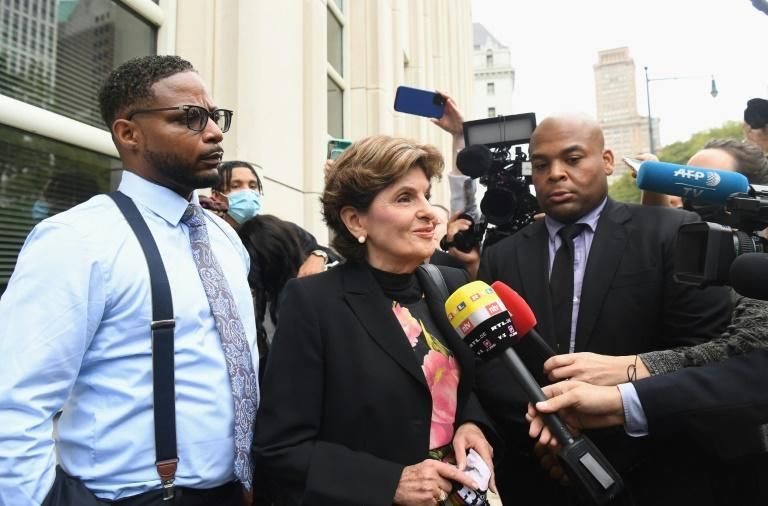 Family members of victim Jocelyn Savage and attorney Gloria Allred speak to the media as they arrive to attend the trial of R. Kelly in New York on August 18, 2021