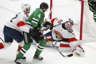 Florida Panthers defenseman Gustav Forsling (42) defends as Dallas Stars defenseman Miro Heiskanen (4) tries to score against Panthers goaltender Chris Driedger (60) in the second period during an NHL hockey game on Sunday, March 28, 2021, in Dallas. (AP Photo/Richard W. Rodriguez)