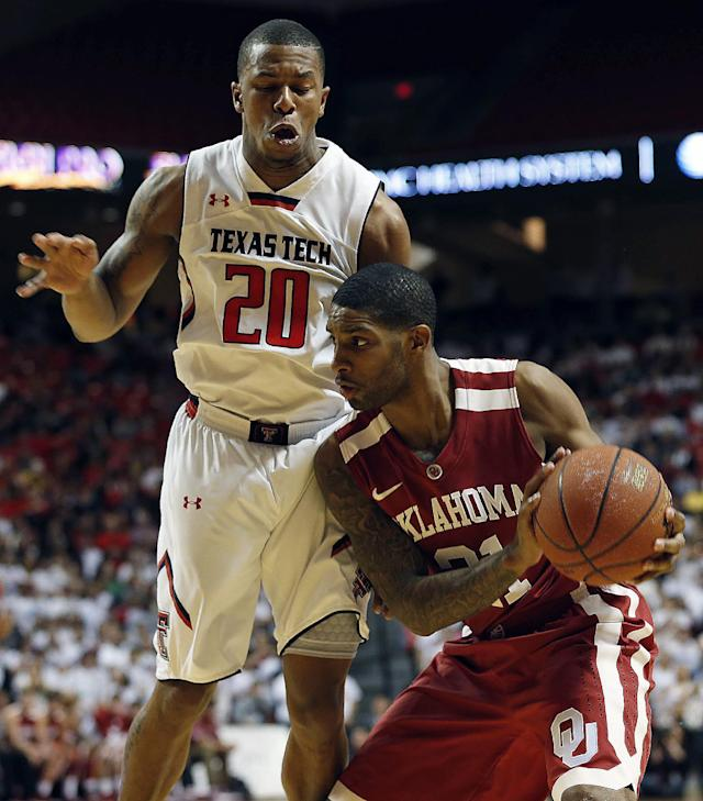 Oklahoma's Cameron Clark, right, looks to pass as Texas Tech's Toddrick Gotcher (20) defends during an NCAA college basketball game in Lubbock, Texas, Saturday, Jan. 25, 2014. (AP Photo/The Avalanche-Journal, Tori Eichberger)