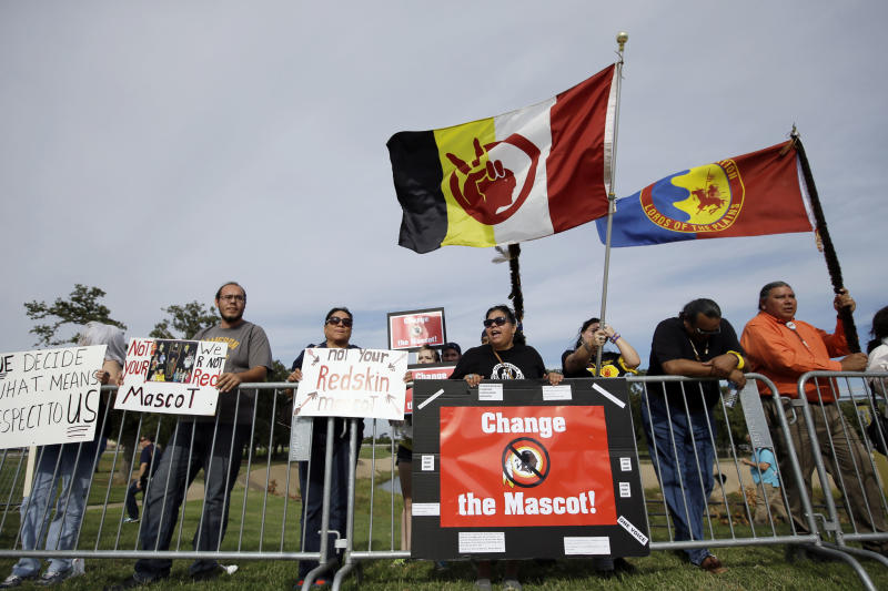 Protestors gather outside of AT&T stadium voicing their stand against the Washington Redskins logo and name before an NFL football game between the Redskins and the Dallas Cowboys, Monday, Oct. 27, 2014, in Arlington, Texas. (AP Photo/Brandon Wade)