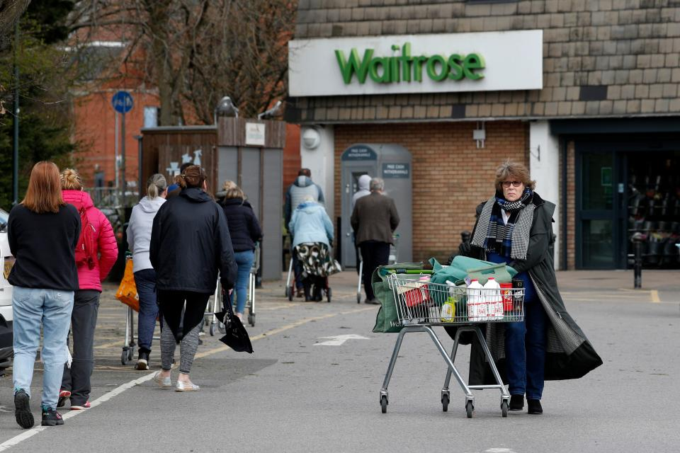 "Shoppers visit a Waitrose supermarket in Frimley, south west of London on March 29, 2020, as life in Britain continues during the nationwide lockdown to combat the novel coronavirus pandemic. - Prime Minister Boris Johnson warned Saturday the coronavirus outbreak will get worse before it gets better, as the number of deaths in Britain rose 260 in one day to over 1,000. The Conservative leader, who himself tested positive for COVID-19 this week, issued the warning in a leaflet being sent to all UK households explaining how their actions can help limit the spread. ""We know things will get worse before they get better,"" Johnson wrote. (Photo by Adrian DENNIS / AFP) (Photo by ADRIAN DENNIS/AFP via Getty Images)"