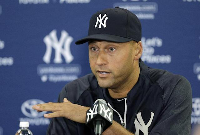 New York Yankees shortstop Derek Jeter gestures during a news conference Wednesday, Feb. 19, 2014, in Tampa, Fla. Jeter has announced he will retire at the end of the 2014 season. (AP Photo/Chris O'Meara)