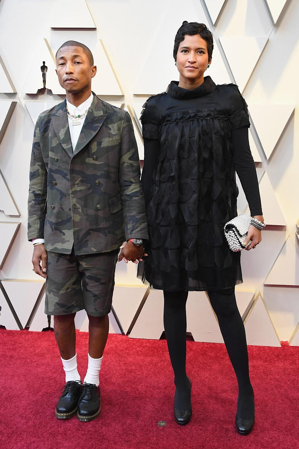 Pharrell Williams in Jacob & Co. jewelry and Helen Lasichanh