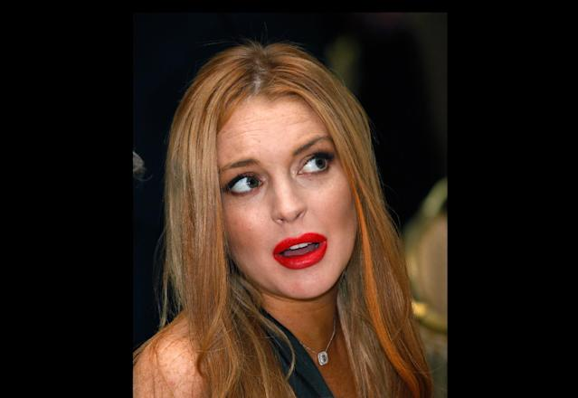 FILE - In this April 28, 2012 file photo, Lindsay Lohan attends the White House Correspondents' Association Dinner in Washington. A law enforcement official says a 25-year-old man got into an argument with Lohan, Sunday, Sept. 30, 2012, in her New York City hotel room over photos on a cellphone and she was physically grabbed or thrown. Authorities confirm that Christian LaBella of Valley Village, Calif., was taken into custody around 6 a.m. He faces a misdemeanor assault charge. (AP Photo/Haraz N. Ghanbari, File)