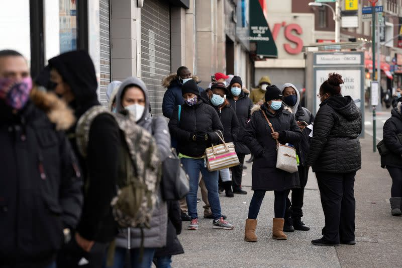 FILE PHOTO: People wait in line to get tested for the coronavirus disease (COVID-19) in the Bronx