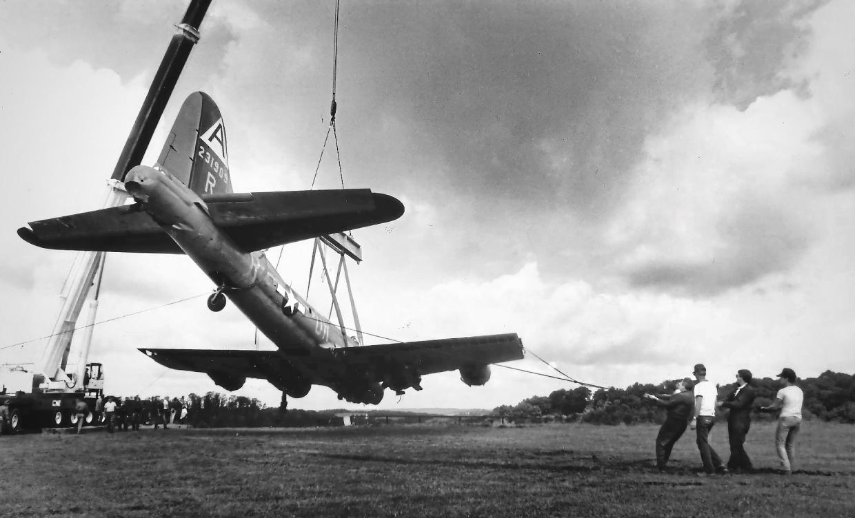 In this Aug. 29, 1987 photo, workers use a cane to lift a World War II-era B-17 plane from its crash site at the Beaver County Airport, in Beaver County, Pa. The same four-engine, propeller-driven B-17 bomber plane with more than a dozen people aboard crashed and burned at the Hartford County Bradley International Airport in Windsor Locks, Conn., after encountering mechanical trouble on takeoff Wednesday, Oct. 2, 2019, killing multiple people. (Susie Post/Pittsburgh Post-Gazette via AP)
