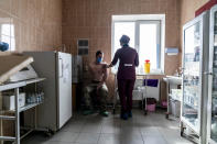 A Ukrainian serviceman receives a dose of the AstraZeneca COVID-19 vaccine marketed under the name CoviShield at a military base in Kramatorsk, Ukraine, Tuesday, March 2, 2021. Ukraine plans to vaccinate 14.4 million people this year, or about 35% of its 41 million people. (AP Photo/Evgeniy Maloletka)