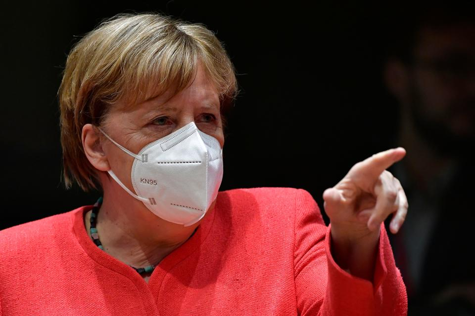 German Chancellor Angela Merkel, wearing a protective face mask, gestures during an EU summit in Brussels on July 20, 2020, as the leaders of the European Union hold their first face-to-face summit over a post-virus economic rescue plan. (Photo by JOHN THYS / POOL / AFP) (Photo by JOHN THYS/POOL/AFP via Getty Images)