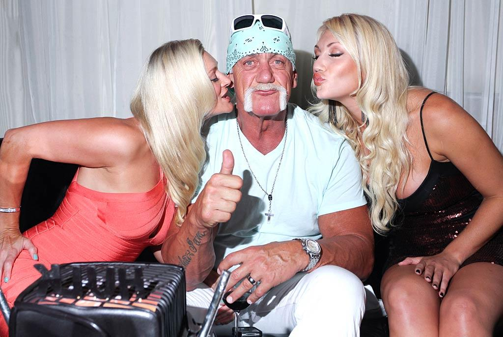 """Former pro wrestler and reality star Hulk Hogan brought his wife of 10 months, Jennifer McDaniel, with him to attend daughter Brooke's portrait unveiling at a charity exhibit benefiting People for the Ethical Treatment of Animals at Miami's Cafeina Lounge on Thursday night. It also happened to be Hulk's 58th birthday, and he looked happy to celebrating with his two favorite ladies. John Parra/<a href=""""http://www.wireimage.com"""" target=""""new"""">WireImage.com</a> - August 11, 2011"""