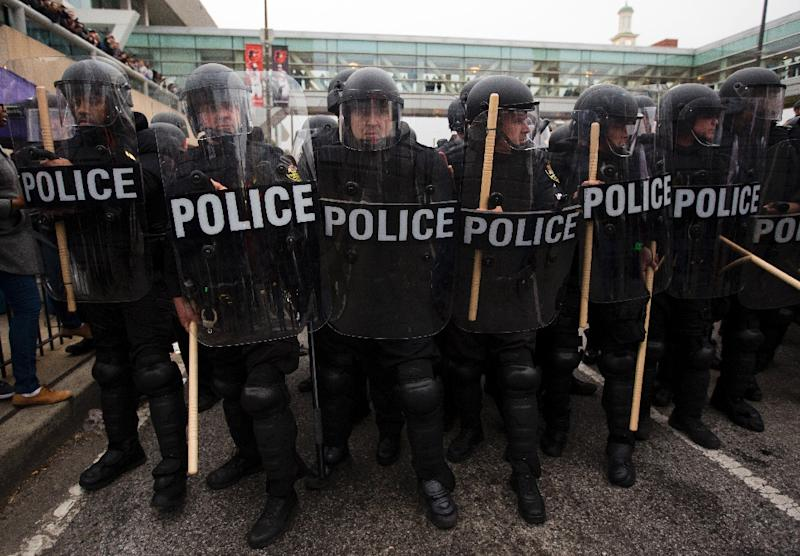 Riot police holding their position during a protest in Baltimore, Maryland against the death of Freddie Gray while in police custody, on April 25, 2015