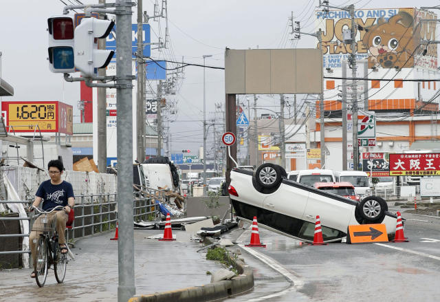 <p>An overturned car is seen on a road following heavy rain in Ozu city, Ehime prefecture, southwestern Japan, July 8, 2018. (Photo: Michi Ono/Kyodo News via AP) </p>
