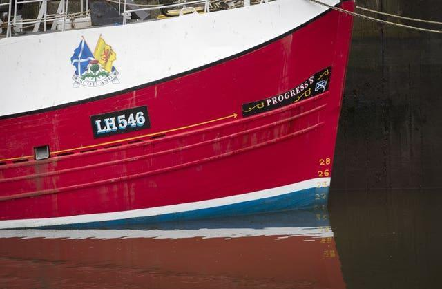 A fishing boat moored in Eyemouth Harbour, in the Scottish Borders (Jane Barlow/PA)