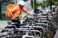 The former Afghan Communication Minister Sadaat works as a bicycle rider for the food delivery service Lieferando in Leipzig