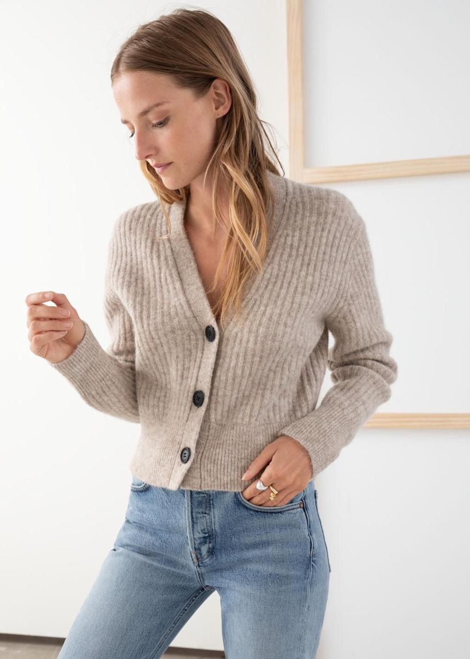 """""""The perfect cardigan is a closet game-changer,"""" says Davignon of the classic wardrobe staple. """"Novelty vintage-esque buttons are sweet and nostalgic details and tactile fabrications are ideal for colder weather."""" (Photo: & Other Stories) <a href=""""https://fave.co/2pvJ3Ez"""" rel=""""nofollow noopener"""" target=""""_blank"""" data-ylk=""""slk:SHOP IT:"""" class=""""link rapid-noclick-resp""""><strong>SHOP IT: </strong></a><strong>& Other Stories Wool Blend Cardigan, $119, </strong><a href=""""https://fave.co/2pvJ3Ez"""" rel=""""nofollow noopener"""" target=""""_blank"""" data-ylk=""""slk:stories.com"""" class=""""link rapid-noclick-resp""""><strong>stories.com</strong></a>"""