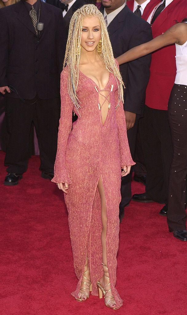 <p>Christina Aguilera has come a long way since this dumpster fire red carpet look in 2001. However, we have a responsibility to acknowledge this major fashion misstep so that history never repeats itself. (Image via Getty Images)</p>