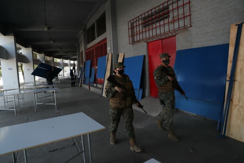 Soldiers patrol inside a polling station ahead of the upcoming referendum on a new Chilean constitution in Santiago