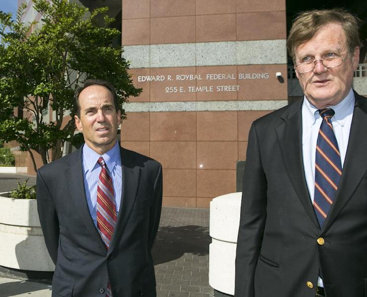 Scott London, former KPMG auditor, left, and his attorney, Harland Braun leave Los Angeles Federal Court on Thursday, April 11, 2013. Federal prosecutors and the Securities and Exchange Commission on Thursday filed criminal and civil charges against fired KPMG partner Scott London for conspiracy to commit securities fraud through insider trading. The criminal complaint alleges that London, 50, of Agoura Hills, Calif., provided confidential information about KPMG clients Herbalife Ltd., Skechers USA Inc., Deckers Outdoor Corp., RSC Holdings and Pacific Capital to Bryan Shaw, a close friend, from late 2010 until last month. Prosecutors allege that Shaw made more than $1.2 million in illicit profits by trading in advance of company announcements on earnings results or mergers. (AP Photo/Damian Dovarganes)