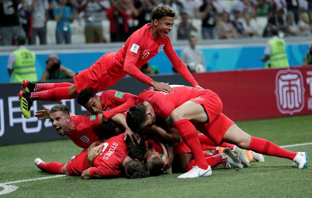 Soccer Football - World Cup - Group G - Tunisia vs England - Volgograd Arena, Volgograd, Russia - June 18, 2018 England's Harry Kane celebrates with team mates after scoring their first goal REUTERS/Ueslei Marcelino TPX IMAGES OF THE DAY