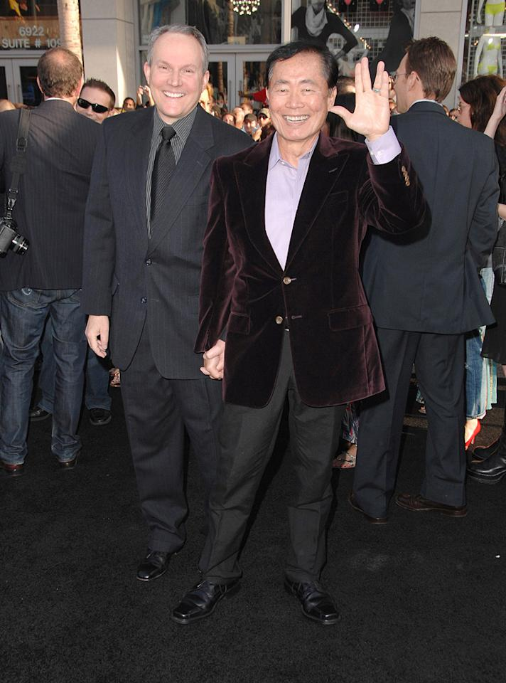 """<a href=""""http://movies.yahoo.com/movie/contributor/1800023561"""">George Takei</a> and guest at the Los Angeles premiere of <a href=""""http://movies.yahoo.com/movie/1809752801/info"""">Star Trek</a> - 04/30/2009"""