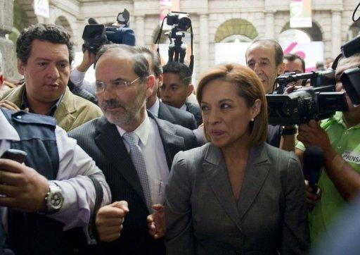 Mexican presidential candidate for the National Action Party (PAN), Josefina Vazquez Mota (R), leaves at the end of the First Citizen Summit organized by Civil Society in Mexico City on May 22. Online social networks, a newcomer in Mexican elections, are making a mark on the country's presidential campaign, forcing candidates to respond to issues and protests enabled by the Internet