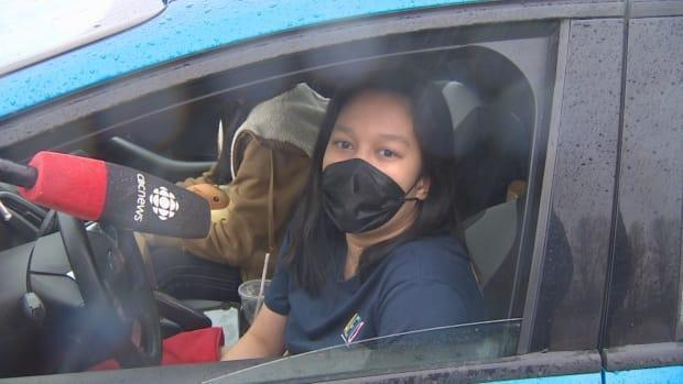 Teen Mary Antoinette Alcab waited at a drive-thru clinic in Regina to get her vaccine Thursday.  (CBC News - image credit)