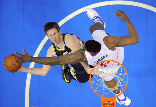 Utah Jazz guard Gordon Hayward, left, puts ups shot as Los Angeles Clippers center DeAndre Jordan defends during the first half of an NBA basketball game, Saturday, Feb. 1, 2014, in Los Angeles. (AP Photo/Mark J. Terrill)