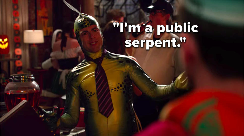 Schmidt is dressed up in a snake costume with a tie and a briefcase and he says, I'm a public serpent