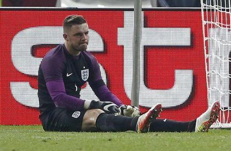 Football Soccer - Germany v England - International Friendly - Olympiastadion, Berlin, Germany - 26/3/16 England's Jack Butland looks dejected after sustaining a injury and is later stretchered off Action Images via Reuters / Carl Recine Livepic/File Photo